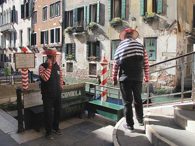 Gondoliers in Venice, Italy