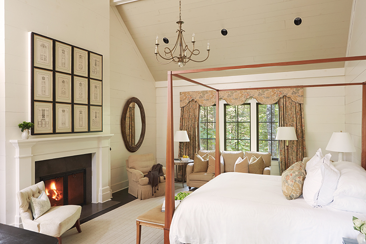 A four-poster bed in a beautifully appointed room